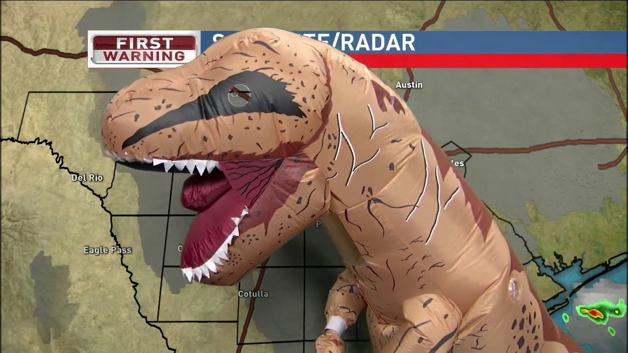 weatherman does halloween forecast in t rex costume - Meteorologist Halloween Costume