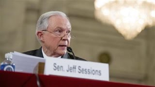 Sessions Defends His Record on Civil Rights as Protesters Interrupt