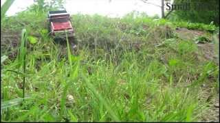 Radio controlled old Tonka dump truck climbing hills.