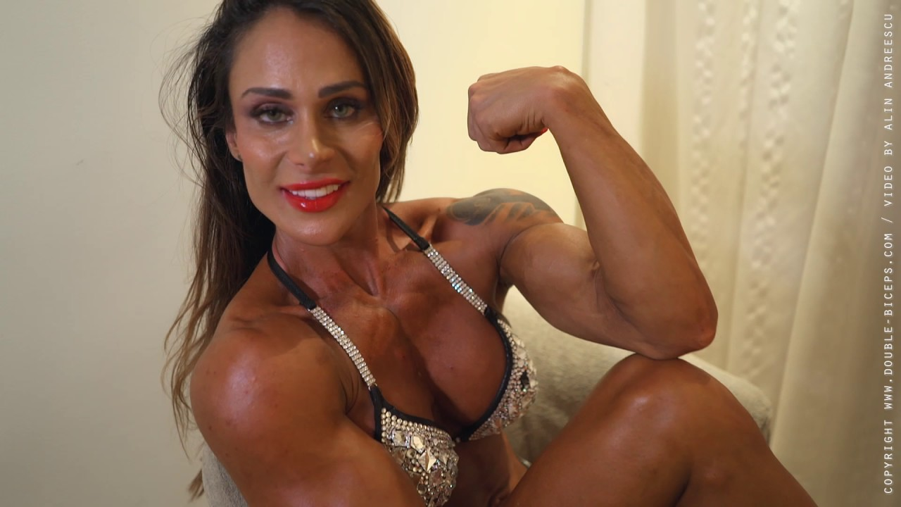 Female domination muscle posing
