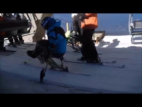 Sit ski self-load on a chairlift