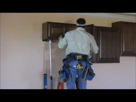 how-to-install-kitchen-wall-cabinets-and-crown-moldings-with-the-pinch-prop-cabinet-jacks