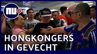 Hongkong: inwoners raken slaags met elkaar