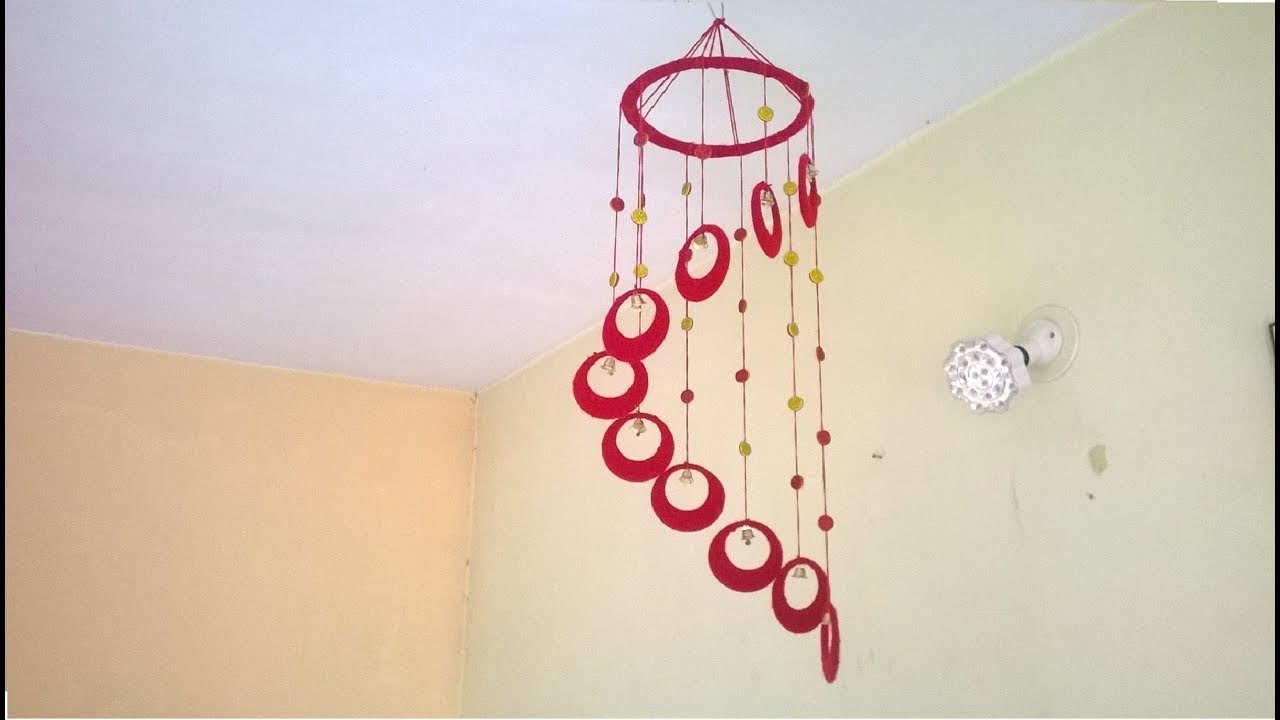 Diy wind chime wall hanging using woolen room for Wall hanging images