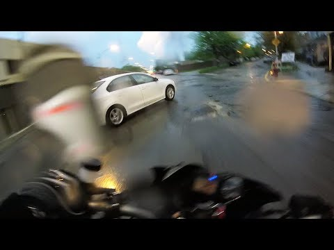 Motorcycle Rider SLAMS into Side of Honda Civic in the Rain!