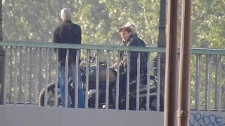 tom cruise dangerously rides his bike without an helmet on the movie set of mi6 in paris