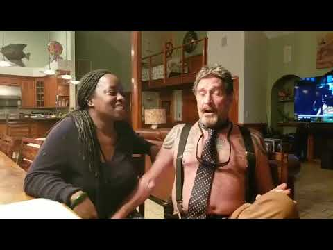 Watch What John McAfee Does With His Beautiful Wife?