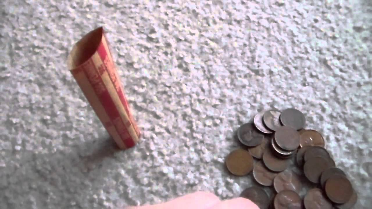 foto How to Put a Coin in a Coin Holder