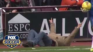 This fan takes one of the craziest dives ever | @TheBuzzer | FOX SOCCER