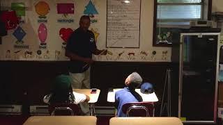AL-Mateen teaches grandkids community, family life goals, & 7 principles of Kwanzaa