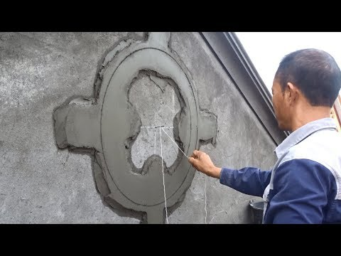 Amazing Construction Rendering Sand And Cement Creating Decorative Circles on Concrete Walls