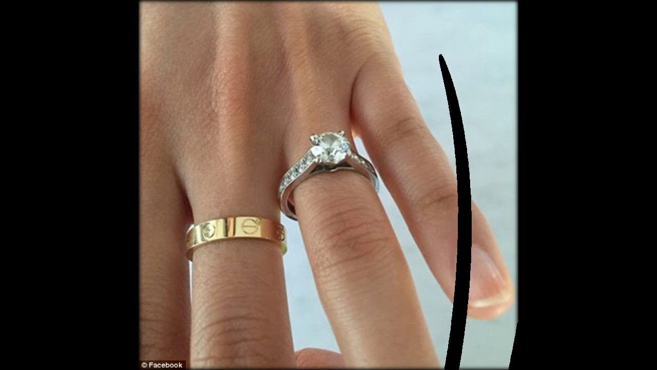 Prince Harry grins as fiance Meghan Markle flashes diamond ring for