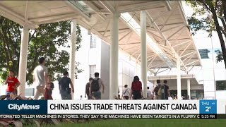 China issues trade threats against Canada...