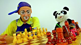 Clown Andrew and a toy Panda play checkers....