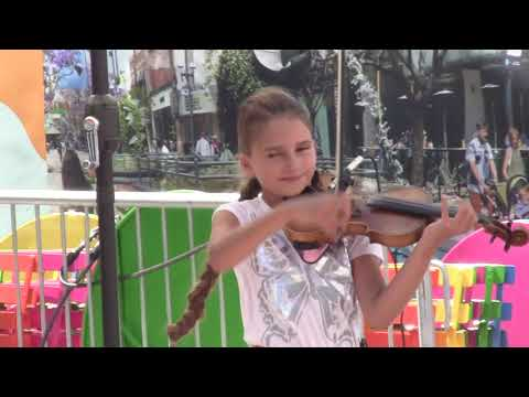 Act 2 of young girl playing Violin on the street thumbnail