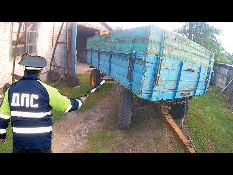 Как ездить на тракторе с тележкой задним ходом видео уроки