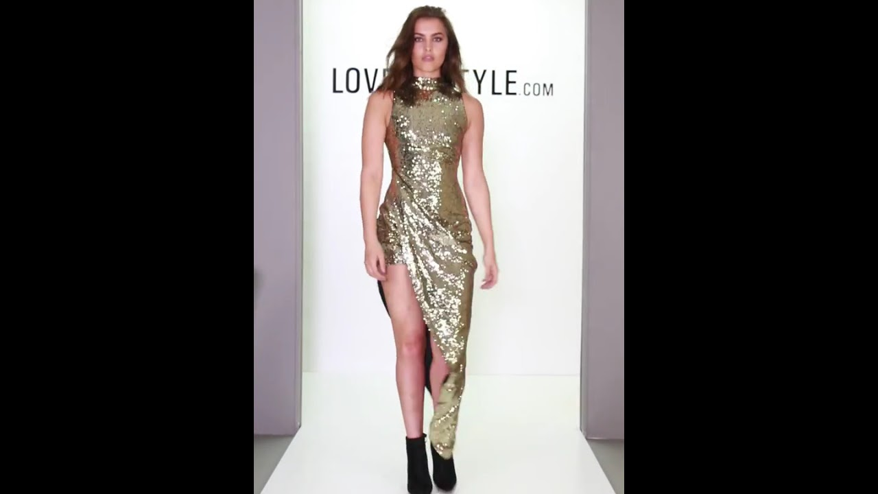 5fe12f3c309 LMS Gold Sequin Wrap Front Dress With High Low Trailing Hem. LoveMyStyle.com