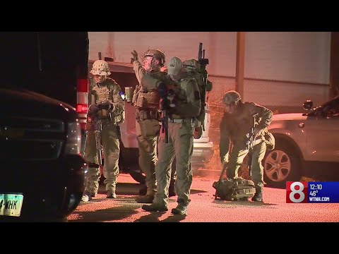 Hours later, man remains barricaded inside Groton home