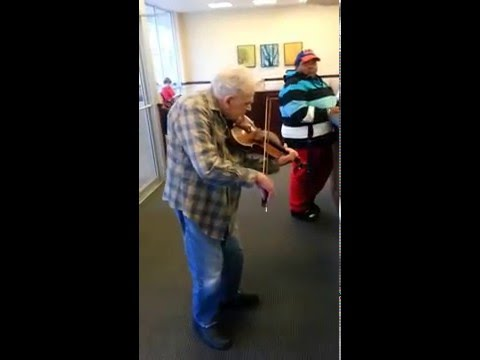 97 yr old freelance strolling violinist. Ed Simons