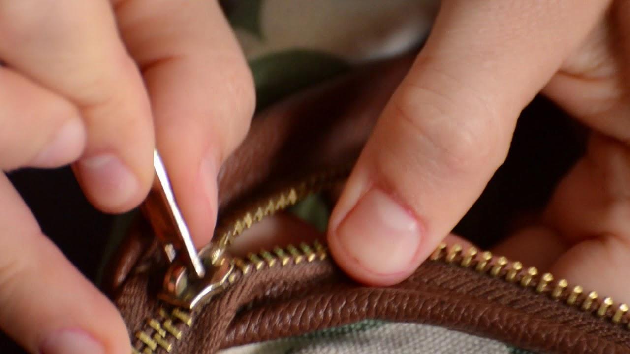 byta dragkedja på väska