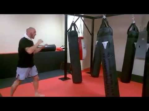Muay Thai Coach Mike Sgroi Kicking Heavy Bags at Grappling Mastery MMA Academy