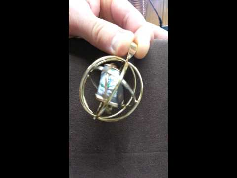 Chalmers Jewelers Opal Gyroscope pendant in motion