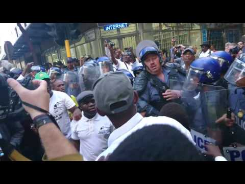 Riot police push pupils away from EFF protestors