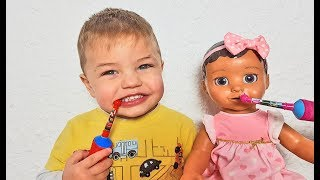 Richard as a dad to a little baby doll