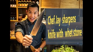 Chef Jay explains how to sharpen a chef's knife on a whetstone