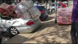 Car crushed by cement bags