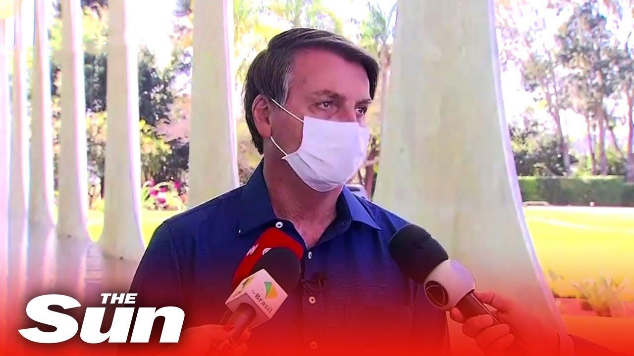 Brazil's President Bolsonaro removes mask next to press as he confirms positive coronavirus result