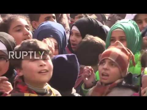 Syria: Aleppo pupils receive school backpacks from Russian children