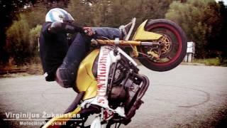 Britva motociklai triukai stun riding kawasaki in Slow Motion
