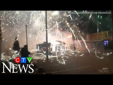 Unexpected firework display as crews battle blaze