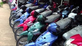 motorbikes in Savannahet, Laos - copied bikes