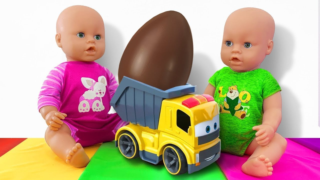 Unpacking Giant Eggs with Surprise Toys And Dolls. Toy Car Dump Truck With Dolls
