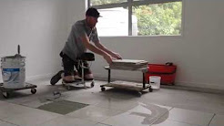 Racatac in Action laying tiles