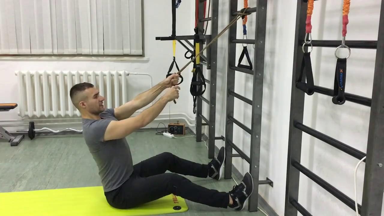 Упражнения для спины дома. Тяга вертикального блока ...
