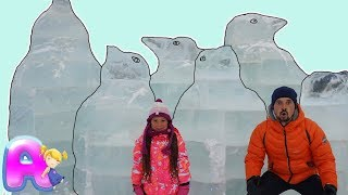 Anna and Dad play with ice Sculpture
