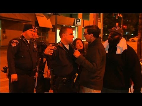 Baltimore police officer confronts CNN reporter