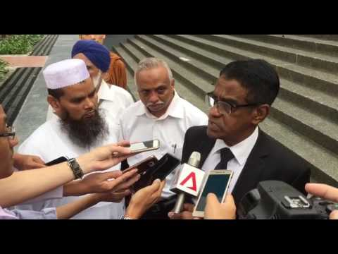 Imam Nalla Mohamed Abdul Jameel's lawyer speaks to reporters after the hearing