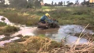 Yamaha timberwolf in the mud