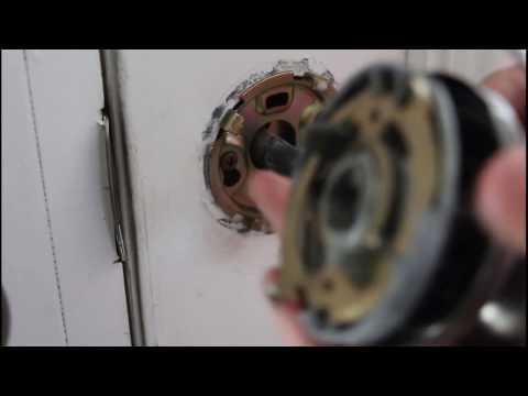 Find hidden screws for a door knob