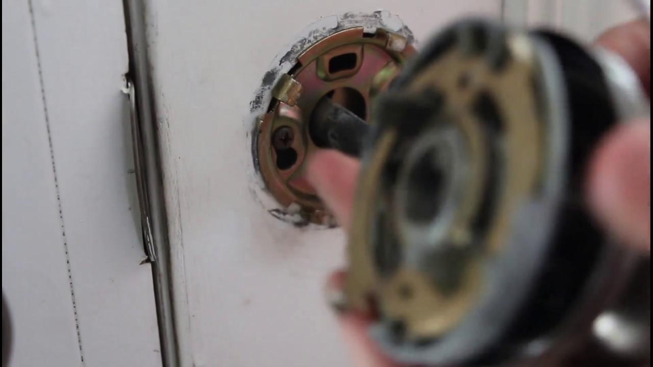 Find hidden screws for a door knob - YouTube