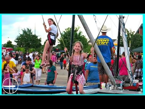 bungee JUMPING at the CARNIVAL, bouncy house racing game w/ 7 kids family fun adventure hopes vlogs