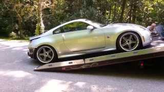 350Z unloading from Right Approach Rollback Flat Bed Tow Truck