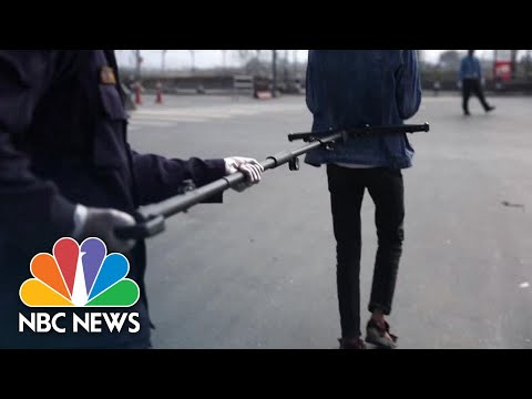 Police In Nepal Use Special Device To Keep Safe Distances During Coronavirus Lockdown   NBC News
