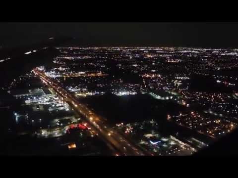 Landing at Houston International airport at night with a Thunderstorm
