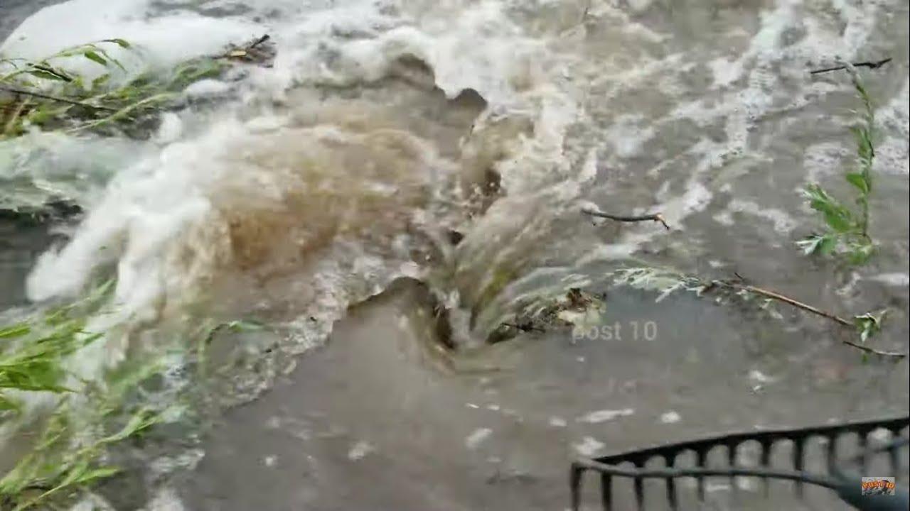 Unclogging Drain During Torrential Downpour Storm