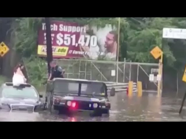 New Jersey officer saves bride stranded in floodwater
